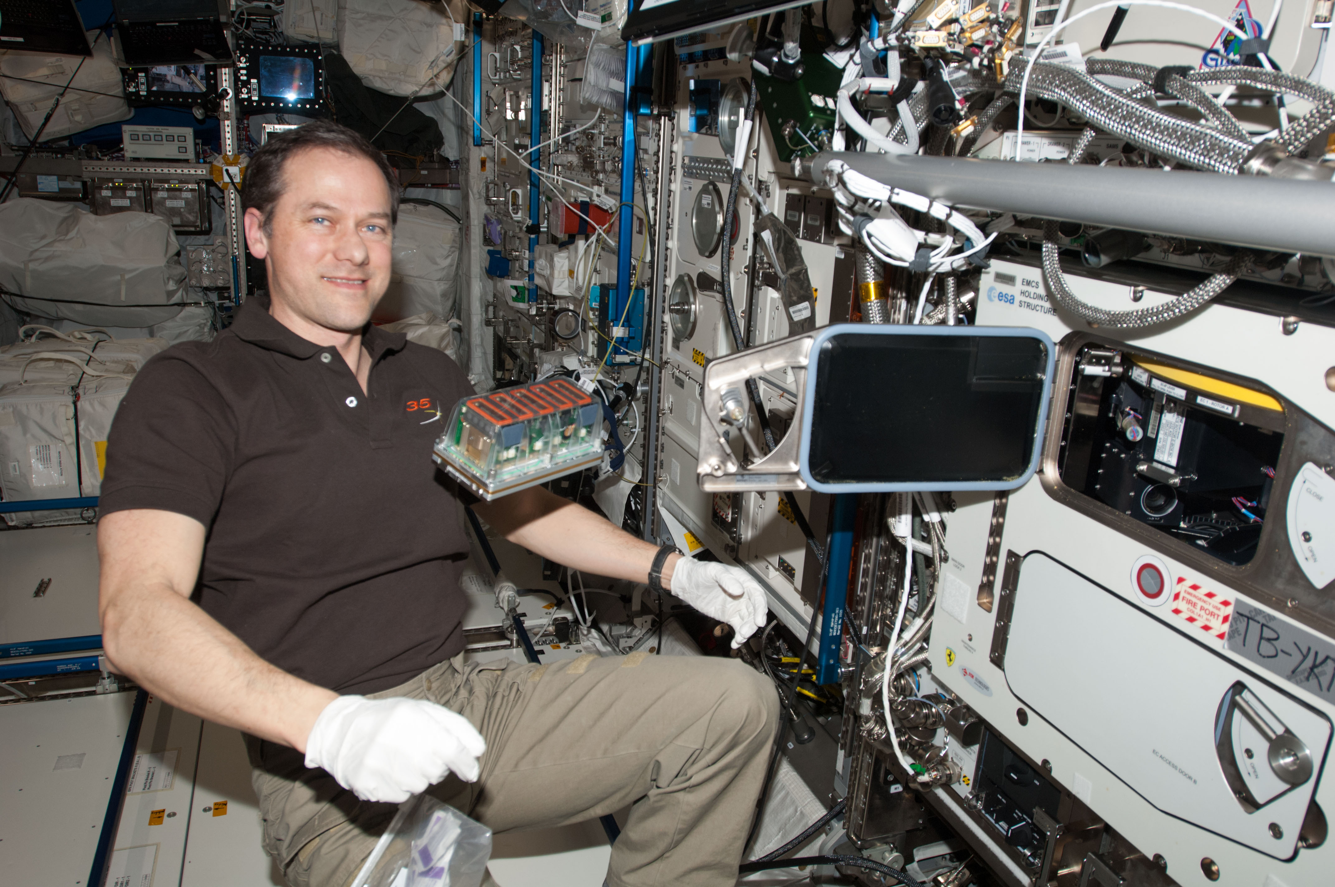 Tom Mashburn at ISS with Seedling Growth (credit: NASA)
